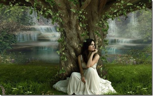 girl sitting under ancient tree